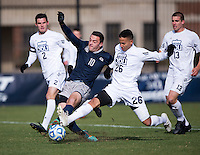 Brandon Allen (10) of Georgetown has the ball tackled away from him by Michael Nelson (26) of Old Dominion during the second round of the NCAA tournament at Shaw Field in Washington, DC. Georgeotown defeated Old Dominion, 3-0.