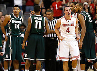 Ohio State Buckeyes guard Aaron Craft (4) reacts after diving on a loose ball in the second half of the NCAA men's basketball game between the Ohio State Buckeyes and the Michigan State Spartans at Value City Arena in Columbus, Ohio, Sunday afternoon, March 9, 2014. The Ohio State Buckeyes defeated the Michigan State Spartans 69 - 67. (The Columbus Dispatch / Eamon Queeney)