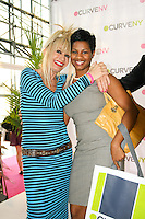 Betsey Johnson and Nesta Findlay pose at the CURVE and CFDA Party For A Cause event during the CURVENY Lingerie & Swim show, at the Jacob Javits Convention Center, August 2, 2010.