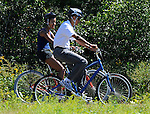 President Obama and his daughter Malia ride bicycles while vacationing on the island of Martha's Vineyard on Friday, August 27, 2010.