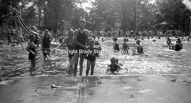 "South Park PA: Stewart children having fun at the South Park Swimming pool - 1929. The philosophy of recreation in the '20s and '30s was different than it is today. The differences between the haves and the have-nots of society was understood differently, and the county parks were called ""the people's country clubs,"" bringing to poorer people the same recreation that the wealthy paid for at private clubs: golf, tennis, swimming, picnicking. The parks offered common folk the chance to escape to rural campgrounds, day camps, and ""retreats."" Certain modern recreational concepts had not yet arrived: people didn't ""swim,"" they ""bathed""; hence, a large South Park pool was only four feet deep at its deepest point."