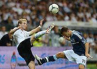 FUSSBALL Nationalmannschaft Freundschaftsspiel:  Deutschland - Argentinien             15.08.2012 Andre Schuerrle (Deutschland) gegen Hugo Campagnaro (Argentinien)