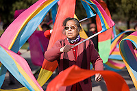 Woman practises tai chi dancing with ribbons in park of the Temple of Heaven, Beijing, China