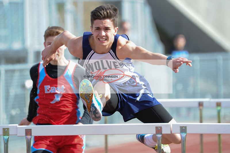 7927 <br /> <br /> Eagle River&rsquo;s Mason Wadsworth clears a hurdle in the boys&rsquo; 100 meter event Friday at Service High.  Photo for the Star by Michael Dinneen