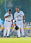 30 June 2012: Vermont Lake Monsters catcher Bruce Maxwell stands safe at third and gets words from Manager Rick Magnante during a game against the Lowell Spinners at Centennial Field in Burlington, Vermont. Mandatory Credit: Ed Wolfstein Photo
