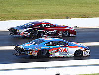 Apr 23, 2017; Baytown, TX, USA; NHRA pro stock driver Allen Johnson (near) alongside Bo Butner during the Springnationals at Royal Purple Raceway. Mandatory Credit: Mark J. Rebilas-USA TODAY Sports