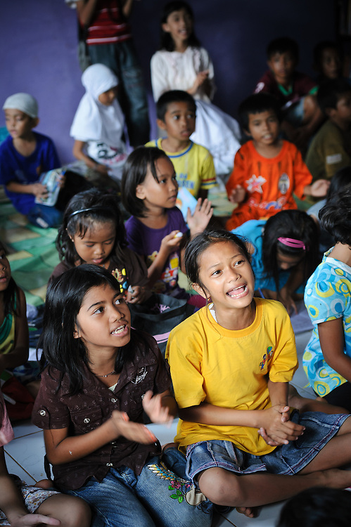 Children singing at the school supported by the Sacred Childhoods Foundation, Makassar, Sulawesi, Indonesia.
