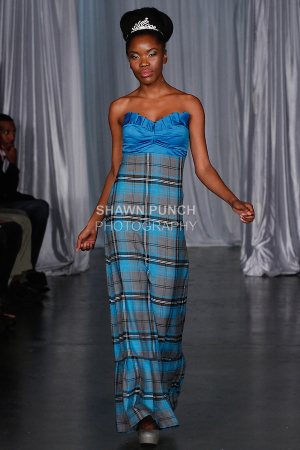 Model walks runway in an outfit from the Kemunto Fashions Spring Summer 2014 collection by Lydia Cutler, during Fashion Week Brooklyn Spring Summer 2014, in Brooklyn, New York on October 5, 2013.