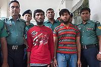 Members of Bangladesh's police force escort two suspected murderer of  blogger Oyasiqur Rahman Babu. Bangladeshi blogger Oyasiqur Rahman Babu hacked to death today around 9:45am at the Tejgaon Indsutrial area in Dhaka, Bangladesh, March 30, 2015. Two madrasa students have been detained with sharp weapons for suspected involvement with the murder. Three meat cleavers have been recovered from the spot. This assassination follows a similar murder of blogger-writer Avijit Roy on Feb 25 at the Dhaka University campus. The two arrested for suspected involvement are  'Zikrullah', a Chittagong madrassa student ,  and Arif', a student of  a madrasa in Dhaka's Mirpur area, according to police.
