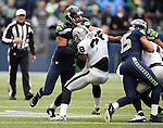 Seattle Seahawks  tight end Luke Willson (82) and wide receiver Jermaine Kearse (15) block during a punt return against the Oakland Raiders at CenturyLink Field in Seattle, Washington on November 2, 2014. The Seahawks beat the Raiders 30-24 in Seattle. ©2014. Jim Bryant Photo. All rights Reserved.