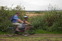Holkham Norfolk, England, 07/08/2009..Cyclists on the North Norfolk coastal path.