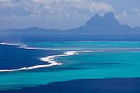 View of Bora Bora and surrounding reefs in the background from Raiatea island