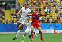 USA's Kristie Mewis (L) and Sarah Steinmann of Switzerland during the FIFA U20 Women's World Cup at the Rudolf Harbig Stadium in Dresden, Germany on July 17th, 2010.