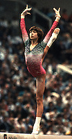 October 23, 1983; Budapest, Hungary; Artistic gymnast Maxi Gnauck of East Germany performs balance on in ring position on balance beam at 1983 World Championships in Budapest.  Copyright 1983 Tom Theobald.Photo note:  Believe there is a high-res version of this image on my big harddrive...need a few days try to find it and re-upload in big size. This comes from an unusual film stock that could be ordered in color negative and color transparency from the processing lab.  This batch of film is not with the set of 4000+ that Barny scanned for me in Germany.  There are films still, I have yet to scan to digital...