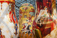 Moscow, Russia, 15/06/2011..Details of an exhibition of of giant Russian matryoshki, or nesting dolls, in the newly-opened Afimall shopping centre. The dolls, designed by Boris Krasnov, are from 6 to 13 metres high, and each is decorated in a different style of traditional Russian folk art..Left - right: Russian Imperial porcelain, Gorodetskaya and Fedoskono styles.