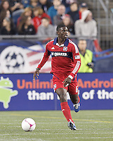 Chicago Fire defender Jalil Anibaba (6) brings the ball forward. In a Major League Soccer (MLS) match, the New England Revolution (blue) defeated Chicago Fire (red), 1-0, at Gillette Stadium on October 20, 2012.