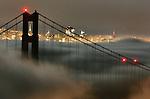 The fog slipped underneath the Golden Gate Bridge of San Francisco, California.