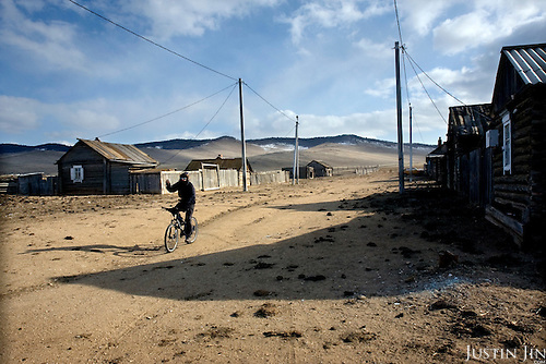 Heleen rides on the empty Yalga village on Olkhon Island on Lake Baikal in Siberia, Russia. .They are a group of five people: Justin Jin (Chinese-British), Heleen van Geest (Dutch), Nastya and Misha Martynov (Russian) and their Russian guide Arkady. .They pulled their sledges 80 km across the world's deepest lake, taking a break on Olkhon, the world's forth-largest lake-bound island. They slept two nights on the ice in -15c. .Baikal, the world's largest lake by volume, contains one-fifth of the earth's fresh water and plunges to a depth of 1,637 metres..The lake is frozen from November to April, allowing people to cross by cars and lorries.