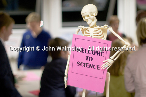 Skeleton welcoming visitors to the Science Dept. during Open Evening at a state Roman Catholic Secondary school.  When next year's 11yr olds and their parents look around the school and talk to staff.