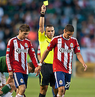 CARSON, CA – June 3, 2011: Chivas USA defender Zarek Valentin (20) receives a yellow card during the match between Chivas USA and Portland Timbers at the Home Depot Center in Carson, California. Final score Chivas USA 1, Portland Timbers 0.