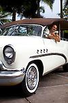 The Four Seasons Resort Hualalai at Historic Kaupulehu on the Big Island of Hawaii. A retro car harkens to days past.