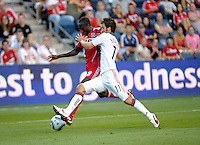 Toronto midfielder Nathan Sturgis (11) pressures Chicago midfielder Dominic Oduro (8).  The Chicago Fire defeated Toronto FC 2-0 at Toyota Park in Bridgeview, IL on August 21, 2011.