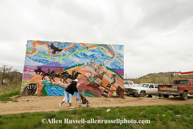 Northern Cheyenne Indian Reservation, Lame Deer, Montana, young Cheyenne father with child, mural depicting problems of alcoholism