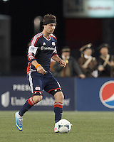 New England Revolution defender Stephen McCarthy (15) brings the ball forward.  In a Major League Soccer (MLS) match, Real Salt Lake (white)defeated the New England Revolution (blue), 2-1, at Gillette Stadium on May 8, 2013.