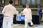 11 February 2017: Duke's Aidan McGinnis (right) and Boston College's MacGregor Mooney (left) begin their Epee match. The Duke University Blue Devils hosted the Boston College Eagles at Card Gym in Durham, North Carolina in a 2017 College Men's Fencing match. Duke won the dual match 18-9 overall, 9-0 Foil, and 6-3 Saber. Boston College won Epee 6-3.