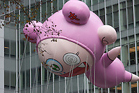 "NEW YORK - NOVEMBER 25:  The Takashi Murakami ""Kiki"" helium filled balloon floats overhead during the annual Macy's Thanksgiving Day Parade  on Thursday, November 25, 2010."