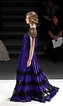 New york, United States. 7th February 2013 -- A model displays a creation by fashion designer Tadashi Shoji during New York Fashion Week, MBFW 2013 in New York. Photo by Kena Betancur / VIEWpress.