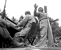 Al Jolson entertains U.S. troops at Pusan Stadium during his visit to the fighting front.  He died shortly after his return from Koera where he gave of his talent untirigly and unceasingly.  He made the trip at his own expense.  September 17, 1950.  Kondreck. (Army)<br /> NARA FILE #  111-SC-348605<br /> WAR &amp; CONFLICT BOOK #:  1468