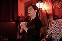 Lisbon, Portugal. 26.03.2015. A Fado singer (Fadista) singing in a restaurant in Alfama, Lisbon, Portugal. © Jane Hobson.