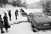 Maramuras, Romania<br /> January1992<br /> <br /> Guide and photographer's car stuck and pulled from the snow and mud by a team of horses.