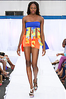 Model walks runway in an Escape The Jungle swimsuit, during the JRG Bikini Under The Bridge 2012 fashion show on July 9, 2012.