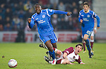 Hearts v St Johnstone...29.01.11  .Cleveland Taylor is brought down by Ruben Palazuelos.Picture by Graeme Hart..Copyright Perthshire Picture Agency.Tel: 01738 623350  Mobile: 07990 594431