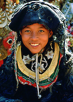 A young child in Bhaktapur in Nepal wearing traditional costume for a festival. RESERVED USE - NOT FOR DOWNLOAD -  FOR USE CONTACT TIM GRAHAM