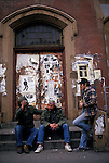 Three men drink alcohol on the stopp of an abandoned building in Manhattan's Lower East side in the 1980s.
