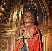 Statue of St Justus by Torcuato Ruiz del Peral, 18th century, on an altarpiece in the Jesuit Church of Saints Justus and Pastor of Alcala, built 1575 on the site of a mosque in Granada, Andalusia, Southern Spain. Saints Justus and Pastor were 4th century schoolboy christian martyrs, who were killed for their faith under the persecution of the christians by the Roman emperor Diocletian. Granada was listed as a UNESCO World Heritage Site in 1984. Picture by Manuel Cohen