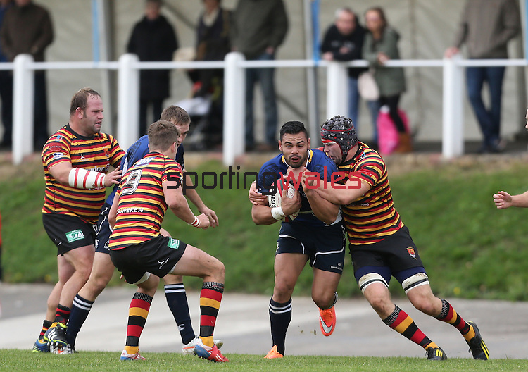 Quins flanker Sion Bennett stops Leinster centre Ben Te'o.<br /> British &amp; Irish Cup<br /> Carmarthen Quins v Leinster A<br /> Carmarthen Park<br /> 25.10.14<br /> &copy;Steve Pope-SPORTINGWALES