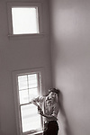 Portrait of mime on stairway by window