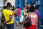 HAVANA, CUBA -- MARCH 25, 2015:   People wait in line for a Cubacel cell phone promotion at Etecsa in Havana, Cuba on March 25, 2015. Photograph by Michael Nagle