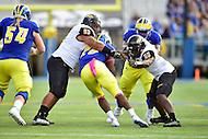 Newark, DE - OCT 29, 2016: Towson Tigers defensive lineman Max Tejada (93) and Towson Tigers linebacker Robert Heyward (50) tackle Delaware Fightin Blue Hens running back Thomas Jefferson (28) during game between Towson and Delaware at Delaware Stadium Tubby Raymond Field in Newark, DE. (Photo by Phil Peters/Media Images International)