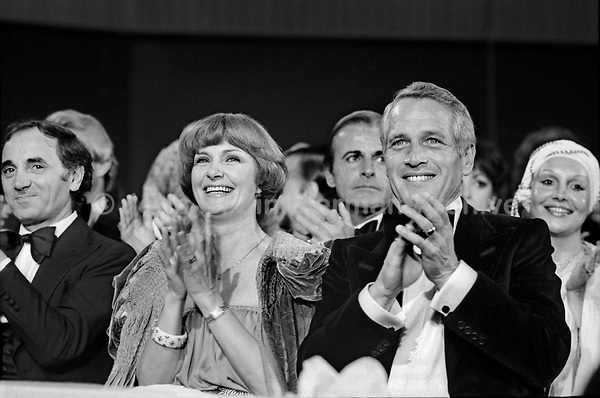 "Actress Joanne Woodward and husband actor Paul Newman applaud at the ""Circus of the Stars,"" (CBS Special), Santa Monica Civic Auditorium, November, 1976. Photo by John G. Zimmerman"