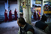 Buddhist monks and Tibetan refugees gather for a candle light vigil in McLeod Gunj  in Dharamsala, Himachal Pradesh, India. Photo: Sanjit Das/Panos