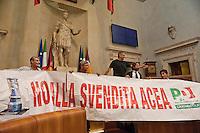 Roma, 11  Luglio 2012.Consiglio comunale in Campidoglio nell'aula Giulio Cesare per  la discussione sulla  cessione del 21% della controllata Acea, l'azienda che si occupa di acqua e servizi. L'opposizione occupa l'aula