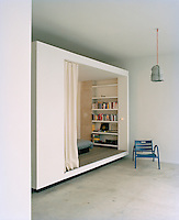 A curtain may be drawn across the entrance to the space-saving box bed in the living area for privacy and comfort
