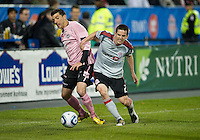 28 April 2010: Toronto FC midfielder Sam Cronin #2 and Montreal Impact midfielder Tony Donatelli #14 in action during a Nutrilite Canadian Championship game between the Montreal Impact and Toronto FC at BMO Field in Toronto..Toronto FC won 2-0.....