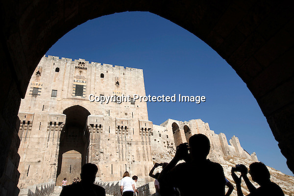 Tourists take photos at the main entrance of the Citadel in Aleppo, Syria on November 07, 2010. (Salah Malkawi for The New York Times)