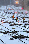 Three Metra Union Pacific employees clear snow from the switches at the throat of the Ogilvy Transportation Center in Chicago. Keeping these switches clear from the quickly falling snow is a very important job as the rush hour approaches.